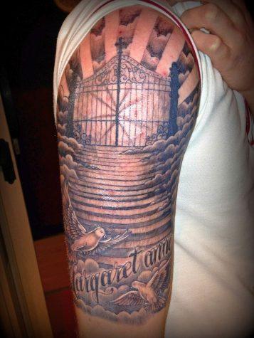 religious tattoos 713x950 00013420 357x475 - religious-tattoos_713x950_00013420
