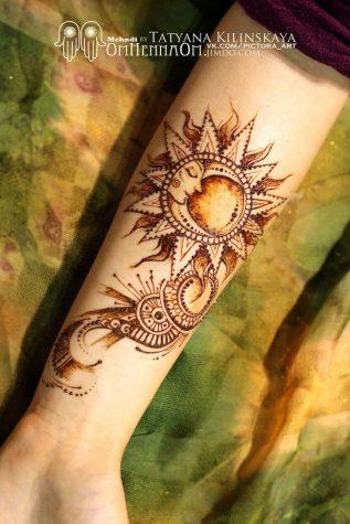 sun tattoo designs 634x950 00015911 317x475 - sun-tattoo-designs_634x950_00015911